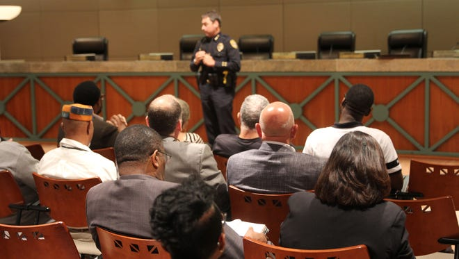 Tallahassee Police Chief Michael DeLeo addresses a crowd at a Tallahassee crime town hall on Aug. 8