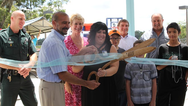 Principal Amy Alvis, right, and Superintendent Rocky Hanna at the ribbon-cutting ceremony Friday, Aug. 11, marking the grand opening of a new home for Heritage Trails Community School, formerly Pace Secondary.