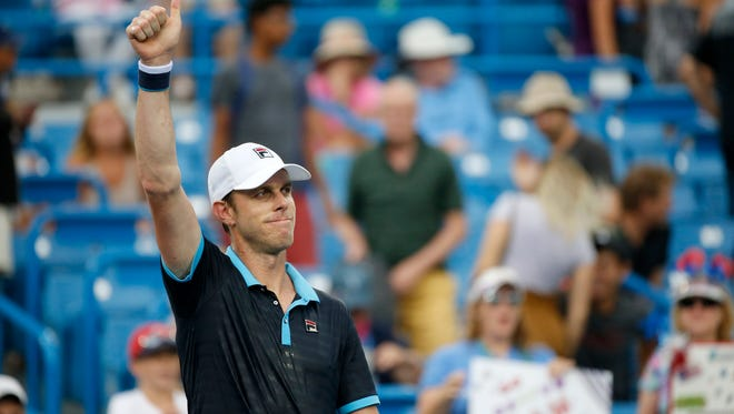 Sam Queerey gives a thumbs up on his victory lap of the court after the match between Stefan Kozlov (USA) and Sam Querrey (USA) during the Western & Southern Open at the Lindner Family Tennis Center in Mason, Ohio, on Monday, Aug. 14, 2017. Queerey won the match, two sets to none, 6-3 and 6-0.