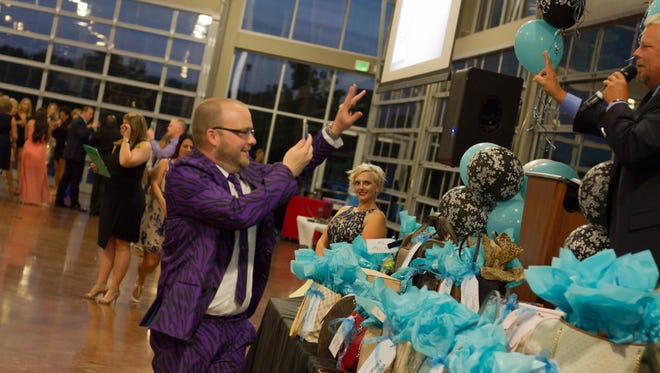 Patrons enjoy Handbags for Hope on Saturday, Aug. 12, at the Wilma Rudolph Event Center in Clarksville. The event was a benefit for Urban Ministry's SafeHouse for Women and the Mike Groves' Memorial Scholarship Fund.