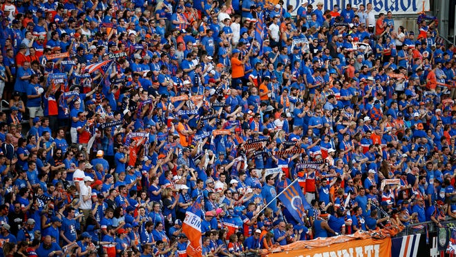 FC Cincinnati fans cheer in the Bailey before the first half of the Lamar Hunt U.S. Open Cup Semifinal match between FC Cincinnati and the New York Red Bulls at Nippert Stadium in Cincinnati on Tuesday, Aug. 15, 2017. The Red Bulls came from a 2-0 deficit to win 3-2 in overtime.