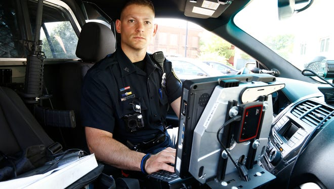 Patrolman Jay Peets inside a police cruiser at Johnson City Police Department on Thursday August 17, 2017.