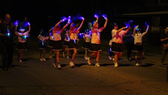 The Mid-Ohio Junior Drill Team performs during the Blue Lights and Bubbles Parade on Thursday, Aug. 17, 2017. The parade is part of the 15th annual Lexington Blueberry Festival.