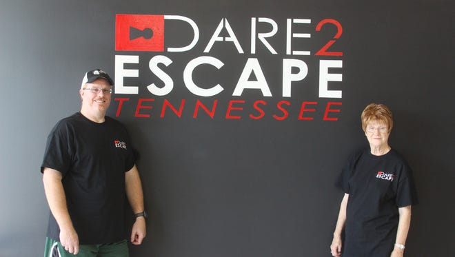 Dare 2 Escape Tennessee owner, Cheryl Coles, right, and manager Jason Coles, left, will open doors to their escape game room center in August 2017.