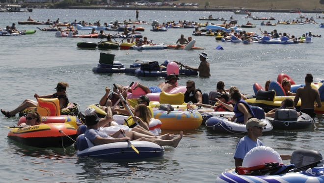 Participants in the annual Float Down take to the water near Lighthouse Park on Aug. 20.