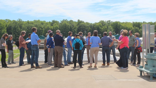 Those attending the The second annual PDPW and UW-Discovery Farms Water Tours listen as officials at the Marshfield Wastewater Treatment Plant Marshfield Wastewater Treatment Plant, discuss treating wastewater with microbes instead of chemicals.