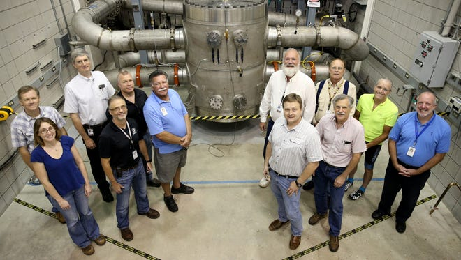 The project team that worked on the National High Magnetic Field Laboratory's newest world-record holding magnet poses with the magnet Tuesday.