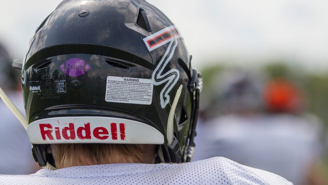 """The Marine City Mariners will wear a purple sticker with the name """"Jacob"""" in it on their helmets at their first game against Algonac Thursday. The sticker is a tribute to Marine City High School student Jacob Lomasney, who died Aug. 17 in a moped crash."""