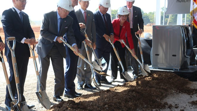 Sec. of Commerce Wilber Ross, second from left, joins officials from LG and city, state and federal leaders at a groundbreaking for the new plant in Clarksville on Thursday.
