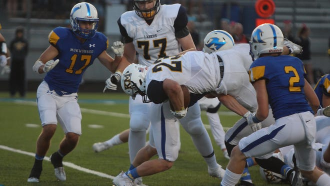 Mike Timm plows over the goal line for the first of his two touchdowns in the first half against Mukwonago on Aug. 25.
