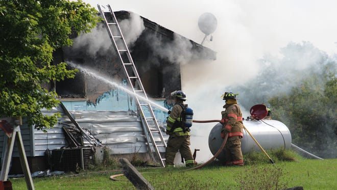 Firefighters battled a fire at a home in the town of Dewey on Wednesday morning.