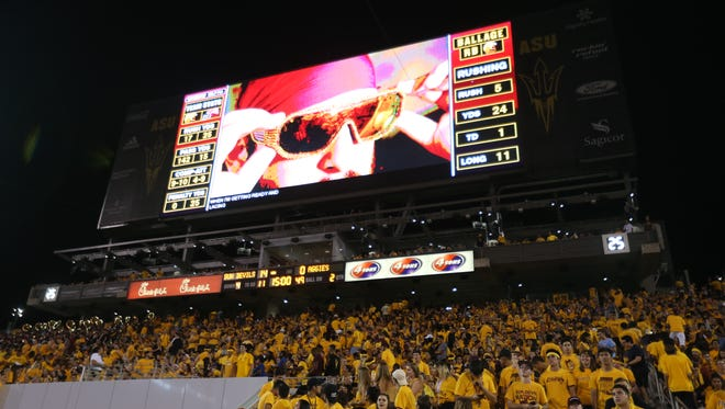 The new video board sits above fans during a game against  New Mexico State at Sun Devil Stadium in Tempe, Ariz. on August 31, 2017.