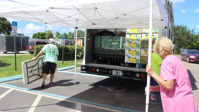 Volunteers helped clean up after the Harry Chapin Food Bank's mobile pantry event on Tuesday, Sept. 5, in Bonita Springs. The event, which was planned in coordination with other area nonprofit agencies, brought aid to flood victims.