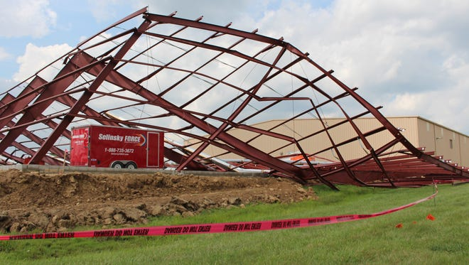 An under-construction addition at Newman Technology's Paragon building collapsed during a storm Monday, Sept. 4, 2017.