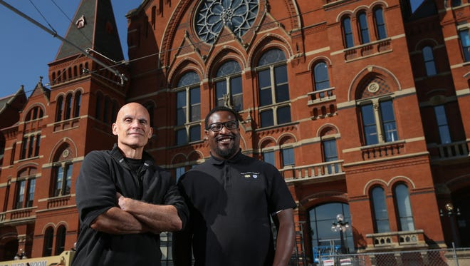 Co-producers of the documentary about the renovation of Music Hall from CET-TV Richard Wonderling, left, and Donald Hancock, right, pictured Wednesday, Sept. 6, 2017, in front of Music Hall in Over-the-Rhine.