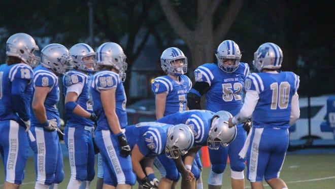 The Whitefish Bay football team gathers for a chat against West Bend West on Sept. 1.