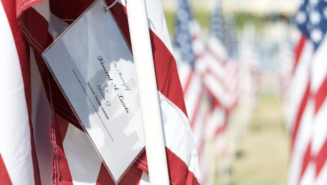 Each American flag has the name of the victim who died in the Sept. 11 terror attacks. This one is in memory of Vincent A. Laieta