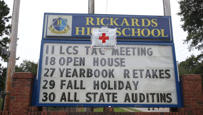 Rickards High School opened as a Red Cross emergency shelter Saturday afternoon. By midday Sunday they were directing evacuees to overflow space in the school's cafeteria.