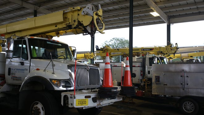 The fleet of city vehicles waits at the City of Tallahassee electric Operations Center on Jackson Bluff Road Sunday.