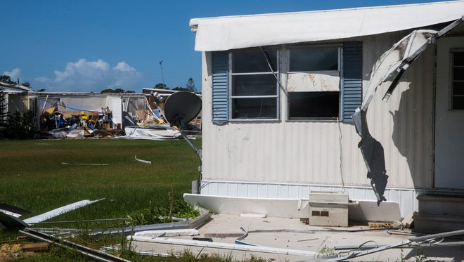 Damage caused by Hurricane Irma in the Tahiti Mobile Village in Estero on Monday, Sept. 11, 2017.