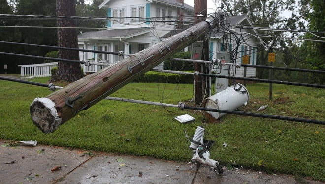 A power pole brought down by a pine tree that fell across the lines, blocking westbound lanes of Mahan Road  Monday morning after Irma blew through Tallahassee.