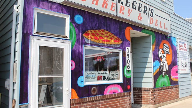 Pies and donuts decorate the front of Kreger's Bakery and Deli.