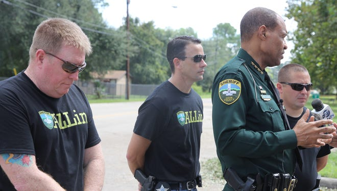 Leon County Sheriff's Office deputies Damon Sullivan (left), Mark McGowan (middle) and Paul Pacchioli (far right) stand with Sheriff Walt McNeil as they prepare to head south to Fort Myers to provide help with recovery efforts following Hurricane Irma.