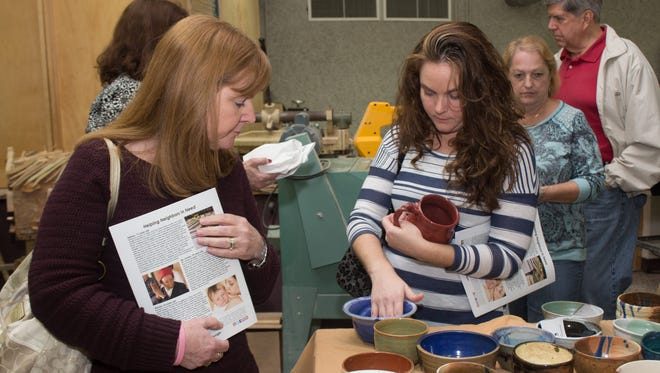 Guests select from handcrafted bowls at a previous Pick a Bowl event for Manna Food Pantries.