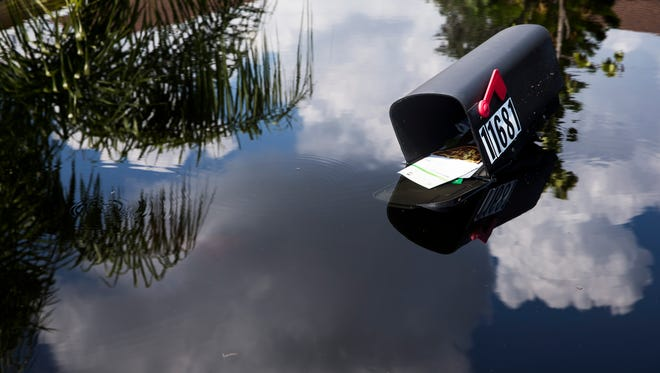 Flood waters touch the bottom of a mailbox along the Quinn Street area in Bonita Springs on Thursday, Sept. 14, 2017, four days after Hurricane Irma.