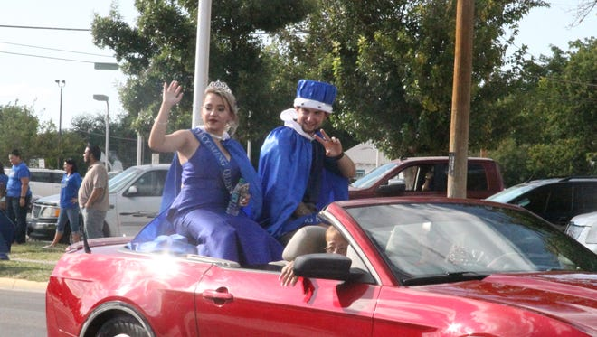 The Carlsbad Early College High School Queen and King, Dalton Bradshaw and Rachel Twaddle, wave to the crowd during the 2017 Carlsbad Homecoming parade.