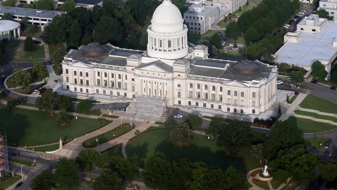 "This May 29, 2015 file photo shows the Arkansas state Capitol building in Little Rock, Ark. In February 2017, Arkansas lawmakers marked the 50-year anniversary of the Freedom of Information Act with a resolution calling it ""a shining example of open government"" that had ensured access to vital public records for generations. They spent the following weeks debating and, in many cases approving, new exemptions to the law in what critics called an unprecedented attack on the public's right to know."