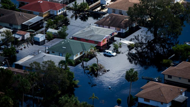 Aerial view of the flooded Quinn Street area in Bonita Springs on Saturday, Sept. 16, 2017, six days after Hurricane Irma.  (AP Photo/Naples Daily News, Nicole Raucheisen)
