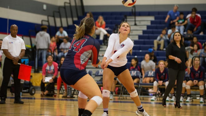 Veterans Memorial's Maddie Guerra bumps the ball during their game against Flour Buff at Veterans Memorial on Tuesday, Sept. 19, 2017.