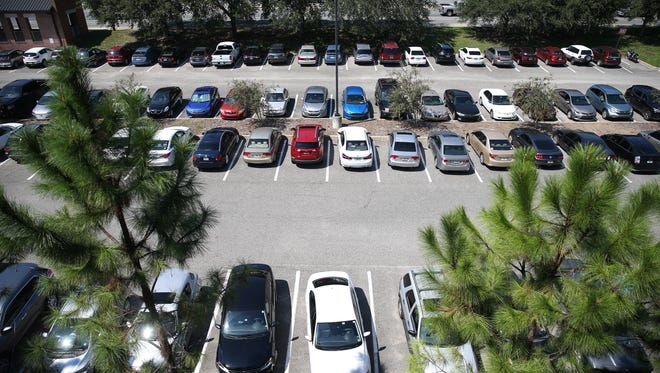 The parking lot next to FSU's College of Medicine l was full, as seen from the top of the Spirit Way garage midday Monday, Sep 18.