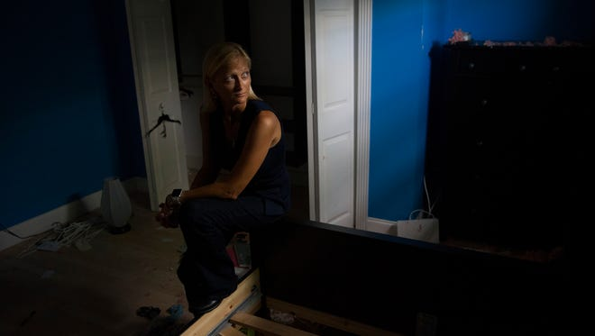 Alex Goetten, 35, was working overtime while sheltering at NCH Baker Hospital Downtown during Hurricane Irma. When she returned home, she had a house with no roof and immense water damage. The damage can be seen here Friday, Sept. 22, 2017, in East Naples, Fla.