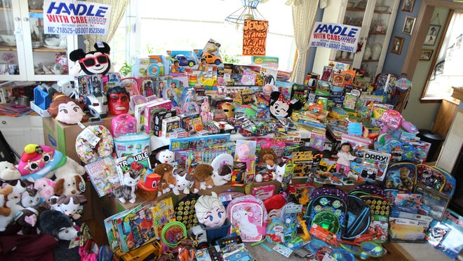 """To offer some comforting """"fun"""" relief, more than 1,000 toys were collected and shipped free by Handle With Care Express in Bound Brook to Houston this month.The effort was spearheaded by Mark and Barbara Nowakowski of South Bound Brook with help from family and friends."""