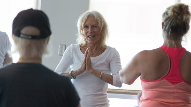 Mindfulness meditation, yoga and stretching, and breath and body awareness techniques deepen thepractice of coping with cancer. instructors Kim Romer, above, and Nancy Aldrich take turns teaching the free classes for cancer patents.