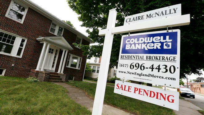 "FILE - In this July 10, 2014, file photo, a ""Sale Pending"" sign is posted in front of a home for sale in Quincy, Mass. On Wednesday, Sept. 27, 2017, the National Association of Realtors releases its August report on pending home sales, which are seen as a barometer of future purchases."