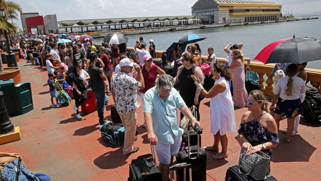Thousands of people evacuating Puerto Rico line up to get on a cruise ship in the aftermath of Hurricane Maria in San Juan, Puerto Rico, Thursday, Sept. 28, 2017. The aftermath of the powerful storm has resulted in a near-total shutdown of the U.S. territory's economy that could last for weeks and has many people running seriously low on cash and worrying that it will become even harder to survive on this storm-ravaged island.