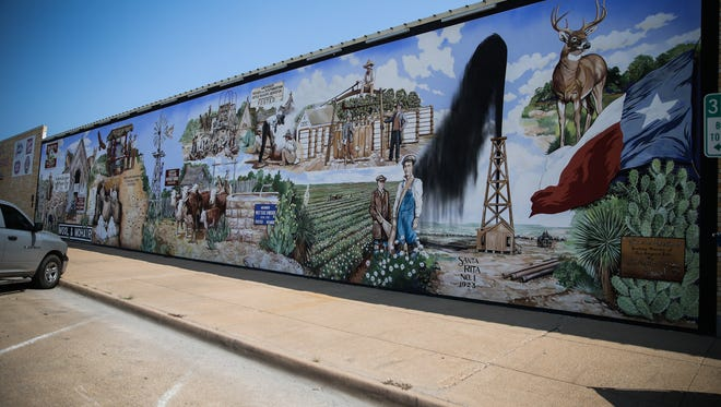 A mural depicting agricultural history of the Concho Valley painted along South Randolph Street in downtown San Angelo.