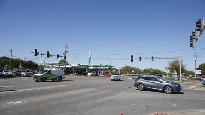 Traffic bustles around the intersection of Ankeny Boulevard and First Street in Ankeny in this 2017 file photo. The intersection, named as the most dangerous in Iowa, is currently undergoing improvements and is among those with traffic lights being retimed.