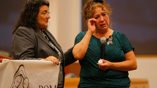 Angie Ortega comforts Felipa Amarillas as she tearfully honors her grandson Joseph Anthony Aguilera who was shot and killed at 20-years-old.