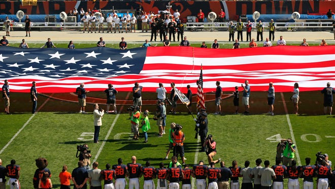 The Pittsburgh Steelers side of the field is nearly empty during the playing of the national anthem before an NFL football game between the Steelers and Chicago Bears on Sunday, Sept. 24, 2017, in Chicago. The Pittsburgh Steelers players did not come out to the field during the anthem.