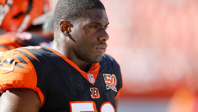 """Cincinnati Bengals linebacker Carl Lawson (58) walks the sideline in the fourth quarter of the NFL Week 4 game between the Cleveland Browns and the Cincinnati Bengals at FirstEnergy Stadium in downtown Cleveland on Sunday, Oct. 1, 2017. The Bengals tallied their first win of the season, 31-7, in the """"Battle for Ohio"""" game."""
