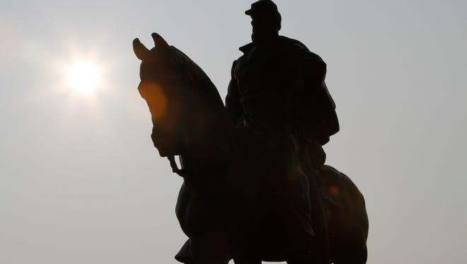The sun rises  behind a statue of Confederate General Stonewall Jackson  as Civil War re-enactors prepare to participate in the First Battle of Manassas 150th Anniversary Commemorative ceremony at the Manassas National Battlefield Park  in  Mannassas, Va., Thursday, July 21, 2011.