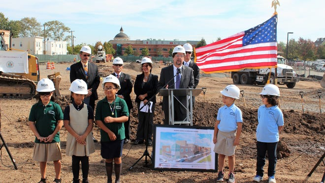 Children help at the groundbreaking for the new Seaman Avenue Elementary School in Perth Amboy.