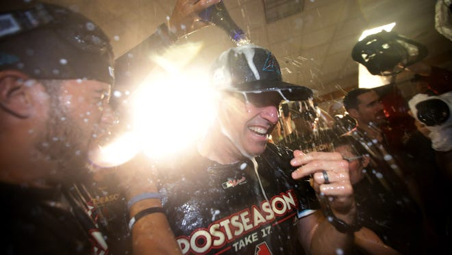 Arizona Diamondbacks manager Torey Lovullo enjoys a champagne celebration in the clubhouse after defeating the Colorado Rockies to win the National League Wild Card game on Wednesday, Oct. 4, 2017 at Chase Field in Phoenix, Ariz.