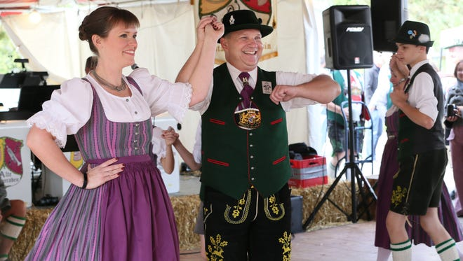 Lauren Forster (left) and Joey Schiller (center right) and fellow members of Wendlstoana Milwaukee, a German dance club, perform traditional Bavarian dance at last year's Cedarburg Oktoberfest.