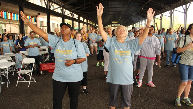 Arms were stretched to the heavens Saturday during the annual River Region Walk in downtown Montgomery Saturday. Alvin Benn/Special to the Advertiser