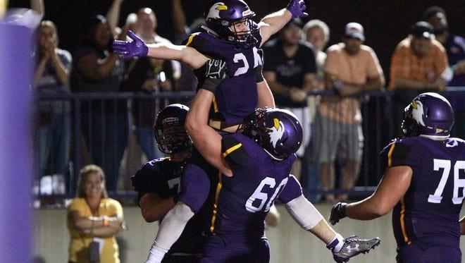 Ashland University running back Andrew Vaughn celebrates a touchdown against Ferris State.